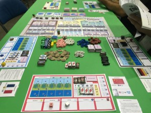 In Manhattan Project: Energy Empire, players must balance many resources: money, plastic, steel, science, oil, workers, energy, and even a clean environment.