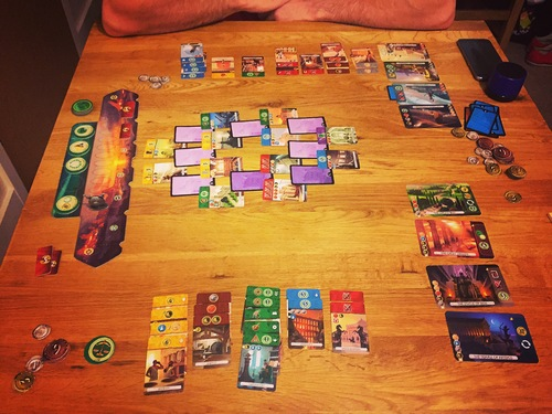 In 7 Wonders: Duel, players choose which cards to acquire, but must earn them by having the correct resources and race to them before their opponent. Image from Board Game Geek.